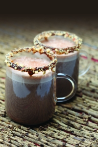 Almond mocha in glass with almond on rim